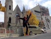 In this Dec. 12, 2020 image taken from video, professional dancer Adrienne Hurd performs in front of the facade of New York City's 128-year-old Middle Collegiate Church, which was devastated by fire the week earlier. Hurd's performance was shown as part of the church's virtual Dec. 20 Advent service. (Lutin Tanner via AP)