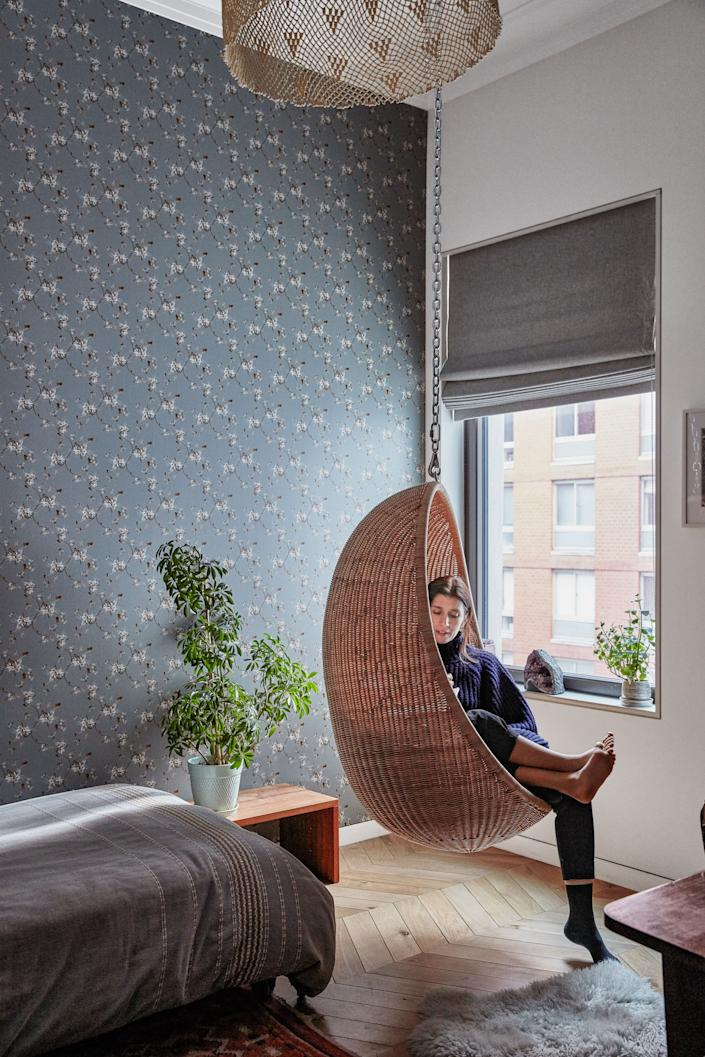 """<div class=""""caption""""> Bergen and daughter Maya lounge in Maya's bedroom, which is clad in Superflower's maple pattern. </div>"""