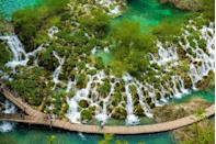 "<p>Manmade boardwalks mark the path in <a href=""https://www.tripadvisor.com/Attraction_Review-g303827-d554038-Reviews-Plitvice_Lakes_National_Park-Plitvice_Lakes_National_Park_Central_Croatia.html"" rel=""nofollow noopener"" target=""_blank"" data-ylk=""slk:Plitvice Lakes National Park"" class=""link rapid-noclick-resp"">Plitvice Lakes National Park</a>. The forest reserve has 16 terraced lakes, joined by waterfalls that lead into a limestone canyon. </p>"
