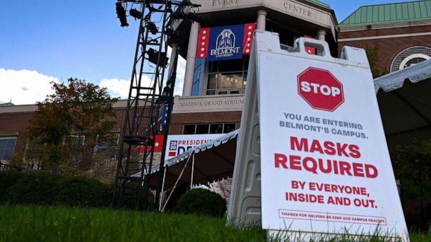 PHOTO: A 'masks required' sign is seen at Belmont University near the entrance of the 2020 U.S. presidential election debate hall on Oct. 21, 2020, in Nashville, Tenn. (Eric Baradat/AFP via Getty Images)
