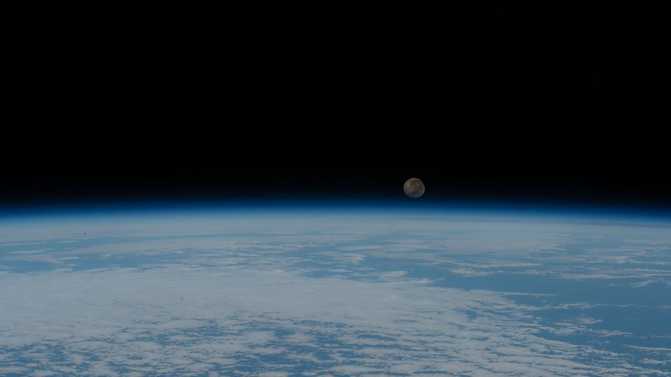 The waning gibbous moon rises over Earth's blue horizon in this photo taken by an astronaut at the International Space Station on Sunday (June 7), two days after the Full Strawberry Moon passed through Earth's outer shadow, causing a subtle penumbral lunar eclipse. An Expedition 63 crewmember captured this view as the space station was orbiting above the Atlantic Ocean, off the coast of the African nation of Angola.