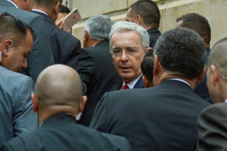 Former Colombian president Alvaro Uribe (C) arrives at the Palace of Justice for a hearing before the Supreme Court in a case over witness tampering