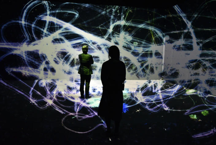 <p>Visitors look at the artwork 'Crows are Chased and the Chasing Crows are Destined to be Chased as well, Blossoming on Collision - Light in Space' by teamLab during the press preview of the exhibition 'The Universe and Art' at Mori Art Museum in Tokyo, Japan, July 28, 2016. (Photo: FRANCK ROBICHON/EPA)</p>