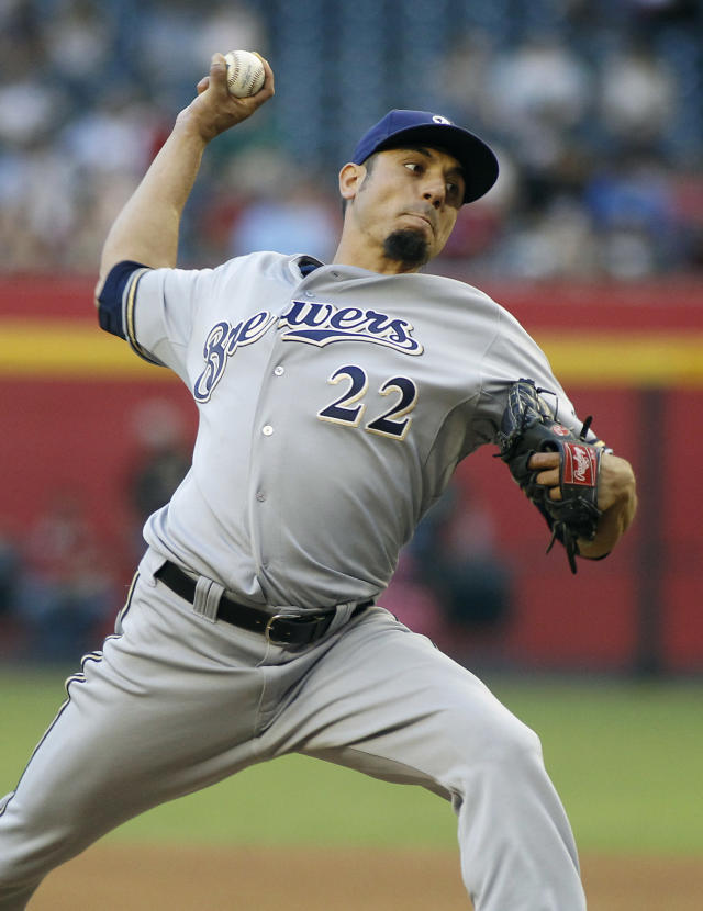 Milwaukee Brewers' Matt Garza throws a pitch against the Arizona Diamondbacks during the first inning of a baseball game on Wednesday, June 18, 2014, in Phoenix. (AP Photo/Ralph Freso)