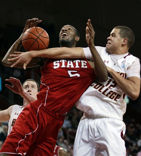 CORRECTS TO NORTH CAROLINA STATE, INSTEAD OF NORTH CAROLINA - North Carolina State's C.J. Leslie (5), left, tries to drive to the basket as Boston College's Ryan Anderson (12), right, reaches to block him during the first half of an NCAA college basketball game in Boston, Wednesday, Feb. 1, 2012. Boston College's Dennis Clifford is at back left. (AP Photo/Steven Senne)