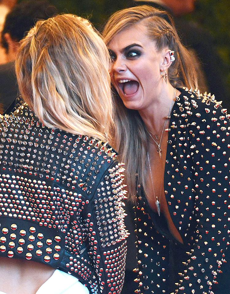 Model Cara Delevingne looked absolutely devastated to be caught wearing a similar look as actress Sienna Miller at Monday night's Met Gala in New York City. Wonder Twin powers, activate! (5/6/2013)