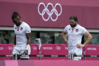 Danny Barrett of the United States, right, and teammate Matai Leuta walk off the pitch after the U.S. lost their men's rugby sevens match against South Africa, at the 2020 Summer Olympics, Tuesday, July 27, 2021 in Tokyo, Japan. (AP Photo/Shuji Kajiyama)