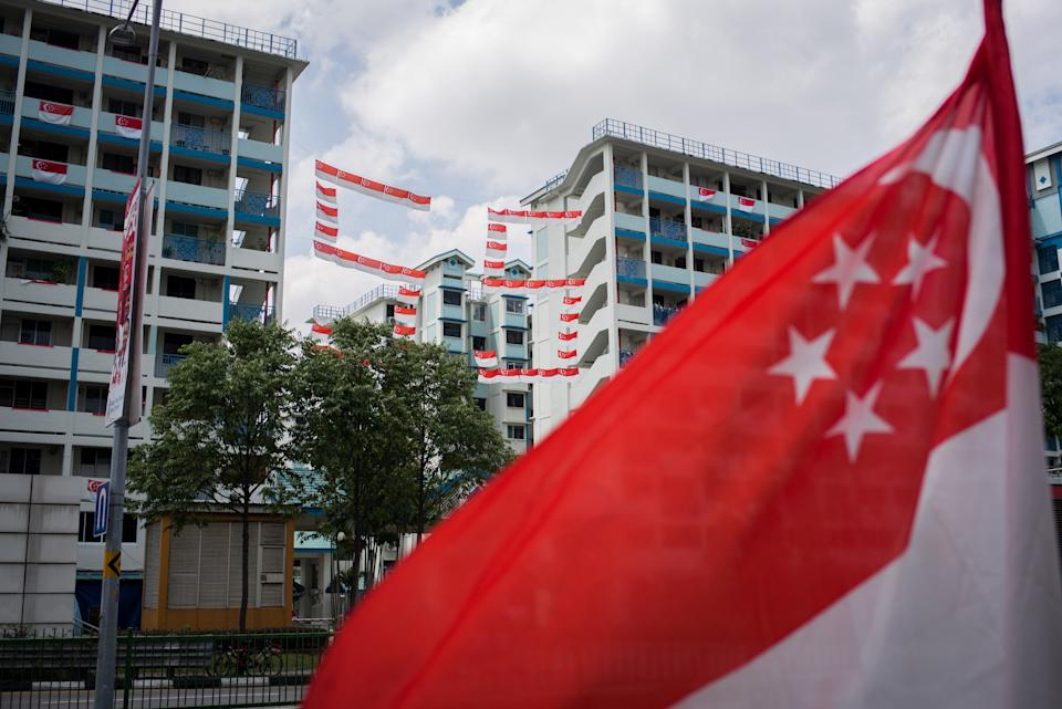 SINGAPORE - 2020/08/09: A number 55 that was made up of Singapore flags seen hanging in between two buildings at a local estate in Singapore. Singapore celebrates its 55th National Day on the 9th of August 2020 amid the Covid-19 pandemic. (Photo by Maverick Asio/SOPA Images/LightRocket via Getty Images)
