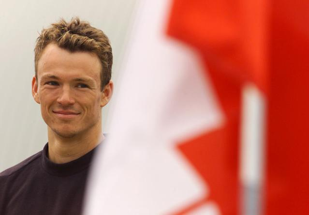 07 Jul 2001: Simon Whitfield of the elite men (CAN) smiles during the Canadian National Anthem after winning the Toronto Triathlon, an International Triathlon Union World Cup event, in the Toronto, Ontario, Canada. DIGITAL IMAGE Mandatory Credit: Brian Bahr/ALLSPORT