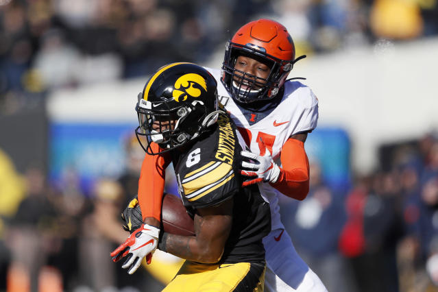 Iowa wide receiver Ihmir Smith-Marsette, left, catches a pass in front of Illinois defensive back Devon Witherspoon during the second half of an NCAA college football game, Saturday, Nov. 23, 2019, in Iowa City, Iowa. Iowa won 19-10. (AP Photo/Charlie Neibergall)
