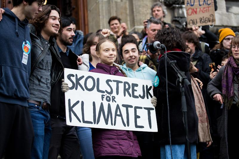 Swedish climate activist Greta Thunberg holds up a sign on January 17, 2019 in Lausanne, Switzerland. The protest is taking place ahead of the upcoming gathering of world leaders in Davos.