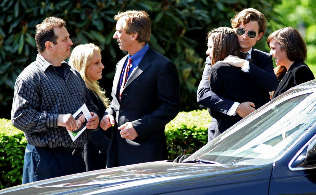 Members of the Kennedy family arrive for the funeral of Mary Richardson Kennedy, the estranged wife of Robert F. Kennedy Jr., at St. Patrick's Church in Bedford, N.Y., Saturday, May 19, 2012. Kennedy was found dead of an apparent suicide this week at her home in Bedford. Robert F. Kennedy Jr., stands third from left. (AP Photo/Craig Ruttle)