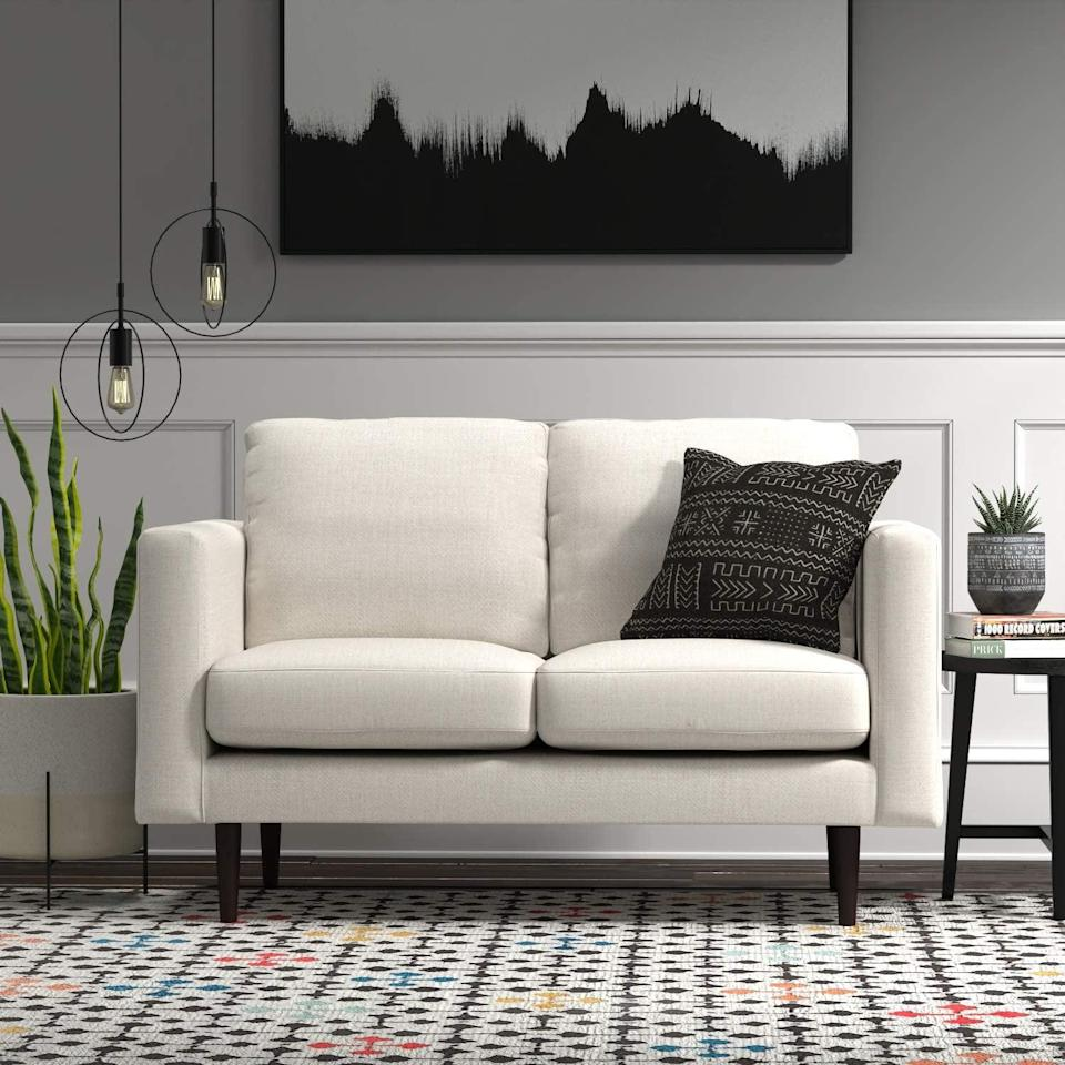 <p>This <span>Rivet Revolve Modern Upholstered Loveseat Sofa</span> ($704) comes in a number of fabrics and color choices.</p>