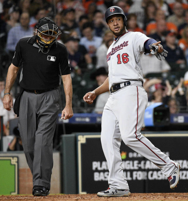 Minnesota Twins' Jonathan Schoop (16) points to Max Kepler after scoring a run on Kepler's single during the seventh inning of a baseball game against the Houston Astros, Tuesday, April 23, 2019, in Houston. (AP Photo/Eric Christian Smith)