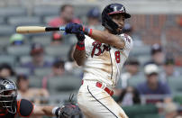 Atlanta Braves' Eddie Rosario swings for a two-run triple against the San Francisco Giants in the sixth inning of a baseball game Sunday, Aug. 29, 2021, in Atlanta. (AP Photo/Ben Margot)