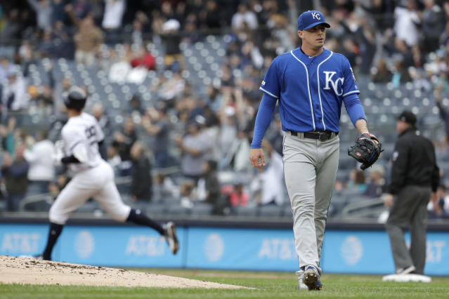 Kansas City Royals relief pitcher Heath Fillmyer, right, looks on as New York Yankees' Aaron Judge, left, runs the bases after hitting a solo home run off him during the first inning of a baseball game, Saturday, April 20, 2019, in New York. (AP Photo/Julio Cortez)