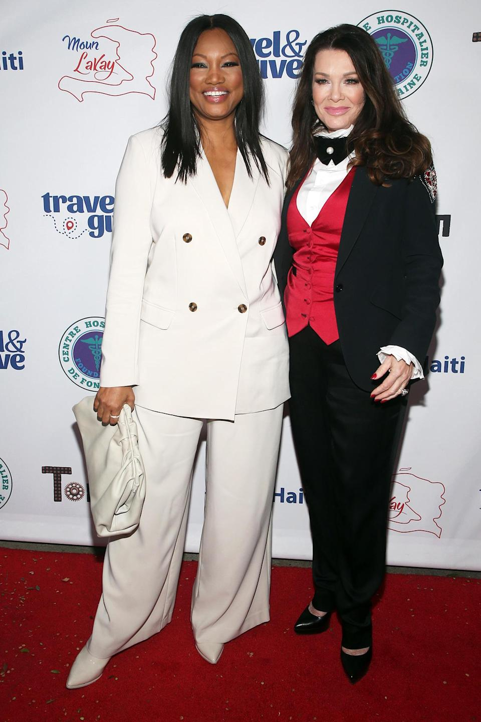 <p><em>Real Housewives</em> star Garcelle Beauvais and <em>Housewives </em>alum Lisa Vanderpump pose together at Travel & Give's 4th Annual Travel with a Purpose fundraiser at Tom Tom in West Hollywood on Oct. 11.</p>