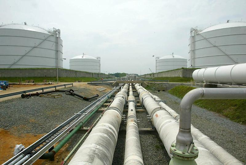 FILE - This June 13, 2003 file photo shows pipelines running from the offshore docking station to four liquefied natural gas (LNG) tanks at the Dominion Resources Inc. Liquefied Natural Gas facility in Cove Point, Md. A domestic natural gas boom already has lowered U.S. energy prices while stoking fears of environmental disaster. Now U.S. producers are poised to ship vast quantities of gas overseas as energy companies seek permits for proposed export projects that could set off a renewed frenzy of fracking. (AP Photo/Matt Houston, File)