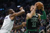 Boston Celtics' Enes Kanter (11) shoots against Charlotte Hornets' Bismack Biyombo (8) during the first half of an NBA basketball game in Boston, Sunday, Dec. 22, 2019. (AP Photo/Michael Dwyer)