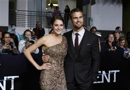 """Cast members Shailene Woodley and Theo James pose at the premiere of """"Divergent"""" in Los Angeles, California in this file photo taken March 18, 2014. REUTERS/Mario Anzuoni/Files"""