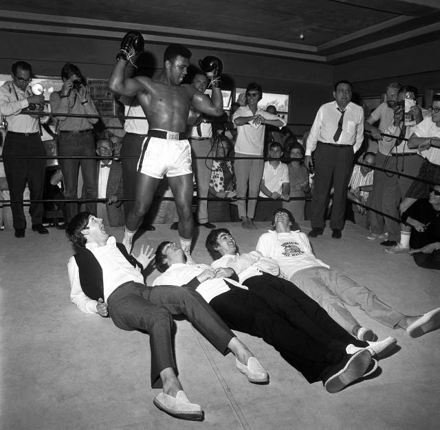 "<p>The Beatles with Cassius Clay, 5th Street Gym, Miami, Florida, 1964. Clay changed his name to Muhammad Ali after his win against Sonny Liston. (Photograph from ""Harry Benson: Persons of Interest"" by Harry Benson, published by powerHouse Books) </p>"