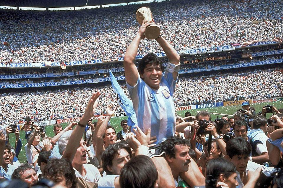 <p>Maradona holds up the World Cup after winning the 1986 final in Mexico</p> (AP)