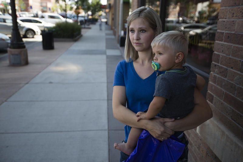 Marlayna Walker holds her 18-month-old son, Zeke, in downtown Gillette, Wyoming. While she has opinions on hot-button social issues, Walker doesn't necessarily want the state legislature to pass laws on those topics. (Josh Galemore/Casper Star-Tribune)