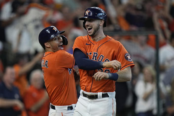 Houston Astros' Kyle Tucker, right, celebrates his two-run homer against the Chicago White Sox with teammate Carlos Correa (1) during the seventh inning in Game 2 of a baseball American League Division Series Friday, Oct. 8, 2021, in Houston. (AP Photo/David J. Phillip)