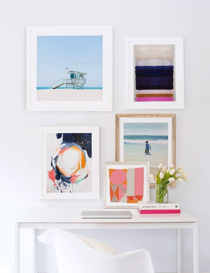 """<h3>Determine A Loose Color Palette</h3> <br>""""Another common misconception is that art has to match. So many people put the same color scheme or subject matter on every wall of a room, or <a href=""""https://web-mintedblue-prodxenial.minted.com/shop-by-look/art/detail/9ac6a099-9c56-42e2-a73a-05f1be0ccb2a/Desk"""" rel=""""nofollow noopener"""" target=""""_blank"""" data-ylk=""""slk:make a gallery wall"""" class=""""link rapid-noclick-resp"""">make a gallery wall</a> with only photos of their family from a single photoshoot. Interiors end up looking like show homes or catalogs. You don't have to collect over time to make it look that way (our stylists can help!) but your interior should look personal to you.<br><br>Always choose art that you love — your personality will automatically shine through. Determine a loose color palette to help keep it all cohesive and ensure that it will integrate well with your décor. Or change your décor to suit the amazing art you just bought!"""" — Art Stylist at <a href=""""https://www.minted.com/"""" rel=""""nofollow noopener"""" target=""""_blank"""" data-ylk=""""slk:Minted"""" class=""""link rapid-noclick-resp"""">Minted</a>.<br><br><strong>Jessica C. Nugent</strong> Venice Beach Print, $, available at <a href=""""https://go.skimresources.com/?id=30283X879131&url=https%3A%2F%2Fwww.minted.com%2Fproduct%2Fart%2FMIN-32E-GNA%2Fvenice-beach"""" rel=""""nofollow noopener"""" target=""""_blank"""" data-ylk=""""slk:Minted"""" class=""""link rapid-noclick-resp"""">Minted</a><br><br><strong>Yours Madly</strong> Block Party, $, available at <a href=""""https://go.skimresources.com/?id=30283X879131&url=https%3A%2F%2Fwww.minted.com%2Fproduct%2Fart%2FMIN-LJC-GNA%2Fblock-party"""" rel=""""nofollow noopener"""" target=""""_blank"""" data-ylk=""""slk:Minted"""" class=""""link rapid-noclick-resp"""">Minted</a><br><br><strong>Annie Seaton</strong> Oxnard Zachary I, $, available at <a href=""""https://go.skimresources.com/?id=30283X879131&url=https%3A%2F%2Fwww.minted.com%2Fproduct%2Fart%2FMIN-8YX-MGA%2Foxnard-zachary-i%3Ffeature%3Ddetail%26event%3DCLICK_SHOP_NOW%26sku%3DMIN-8"""