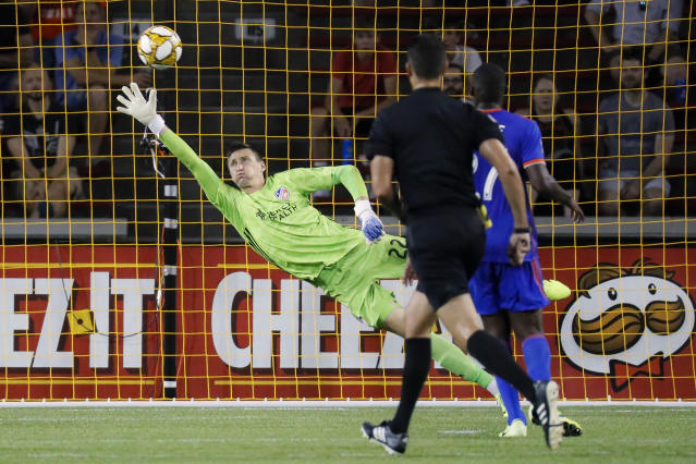 Atlanta United goalkeeper Przemyslaw Tyton is scored on by Atlanta United forward Josef Martinez in the second half of an MLS soccer match, Wednesday, Sept. 18, 2019, in Cincinnati. (AP Photo/John Minchillo)
