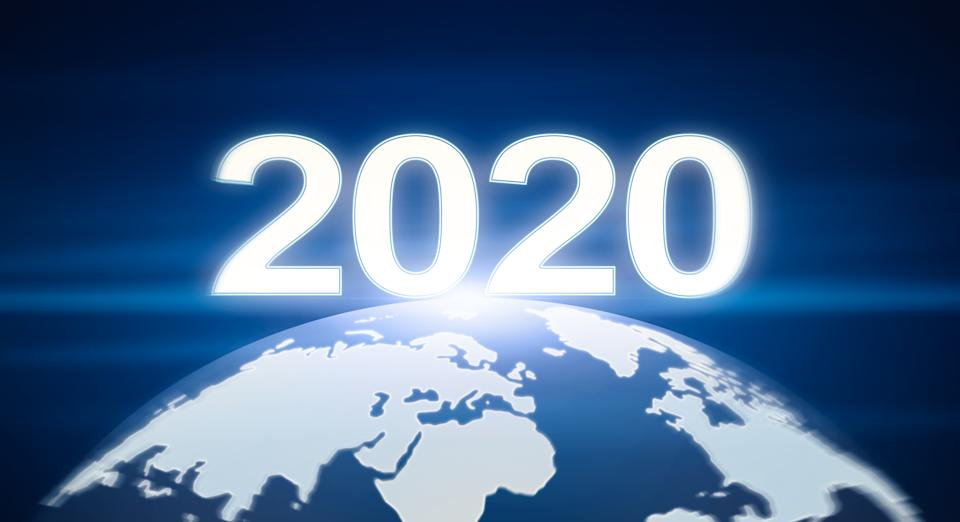New Year coming concept. Planet Earth with glowing numbers 2020 like sunrise, panorama