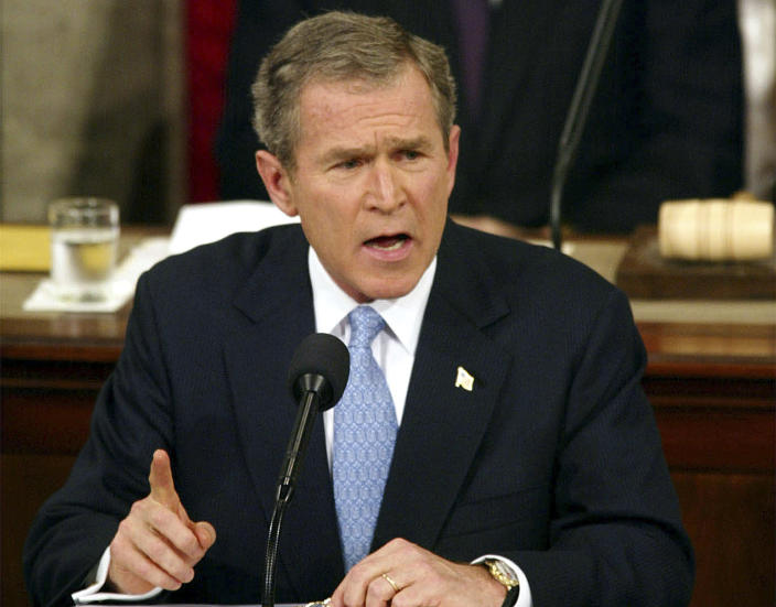 """FILE - In this Jan. 29. 2002, file photo, President George W. Bush labels North Korea, Iran and Iraq an """"axis of evil"""" during his State of the Union address on Capitol Hill. What followed was a U.S.-led invasion of a country in the heart of the Middle East that spurred a decade of war, with consequences that reverberate across the region to this day. (AP Photo/Doug Mills, File)"""