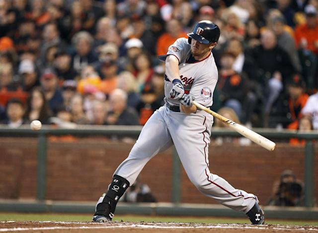 Minnesota Twins' Chris Parmelee drives in a run against the San Francisco Giants in the third inning of a baseball game Friday, May 23, 2014, in San Francisco. (AP Photo/Tony Avelar)