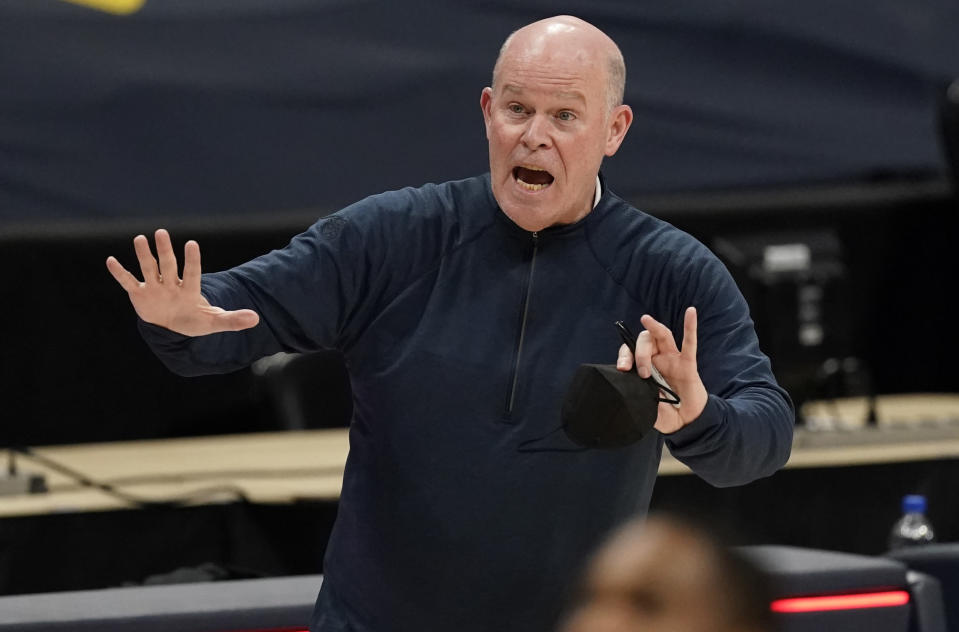 FILE - In this April 4, 2021, file photo, Orlando Magic head coach Steve Clifford directs his team in the second half of an NBA basketball game against the Denver Nuggets in Denver. Clifford will not be back as coach of the Magic next season, a person with direct knowledge of the decision said Saturday, June 5, 2021. The decision was mutual, said the person who spoke to The Associated Press on condition of anonymity because the move had not been publicly announced. (AP Photo/David Zalubowski, File)
