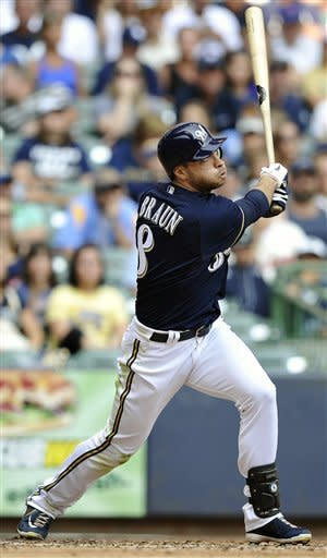 Milwaukee Brewers' Ryan Braun watches his solo home run against the New York Mets during the fourth inning of a baseball game, Sunday, Sept. 16, 2012, in Milwaukee. (AP Photo/Jim Prisching)