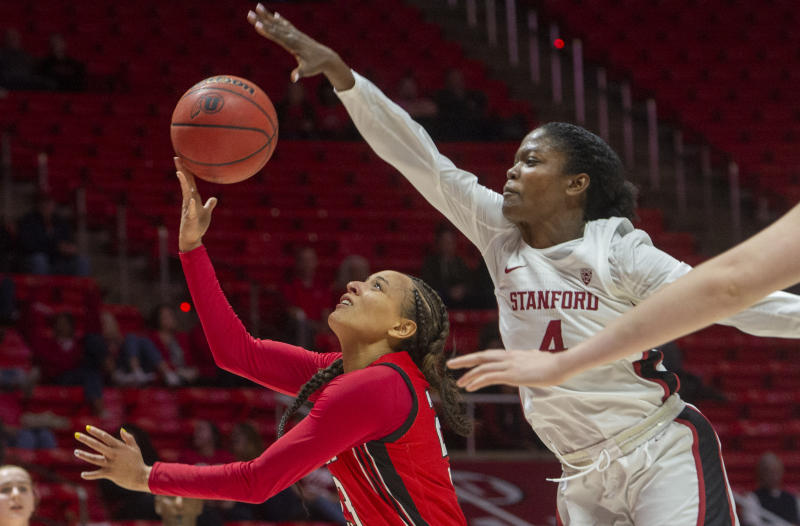 Utah guard Daneesha Provo (23) takes the ball to the basket as Stanford forward Nadia Fingall (4) defends during an NCAA college basketball game Friday, Feb. 14, 2020, in Salt Lake City. (Rick Egan/The Salt Lake Tribune via AP)