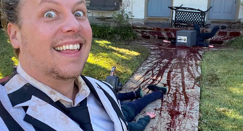 Steven Novak in front of his home in Dallas with Halloween decorations. Fake blood is seen splattered on the footpath.