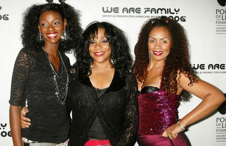 FILE PHOTO: One of the original members of the music group 'Sister Sledge' Joni Sledge (C) poses with family members, niece Camille Sledge (L) and cousin Amber Sledge (R) at the CD launch party for the 'We Are Family' CD and DVD All-Star Katrina benefit CD in Los Angeles, California August 14, 2006. REUTERS/Fred Prouser/File photo