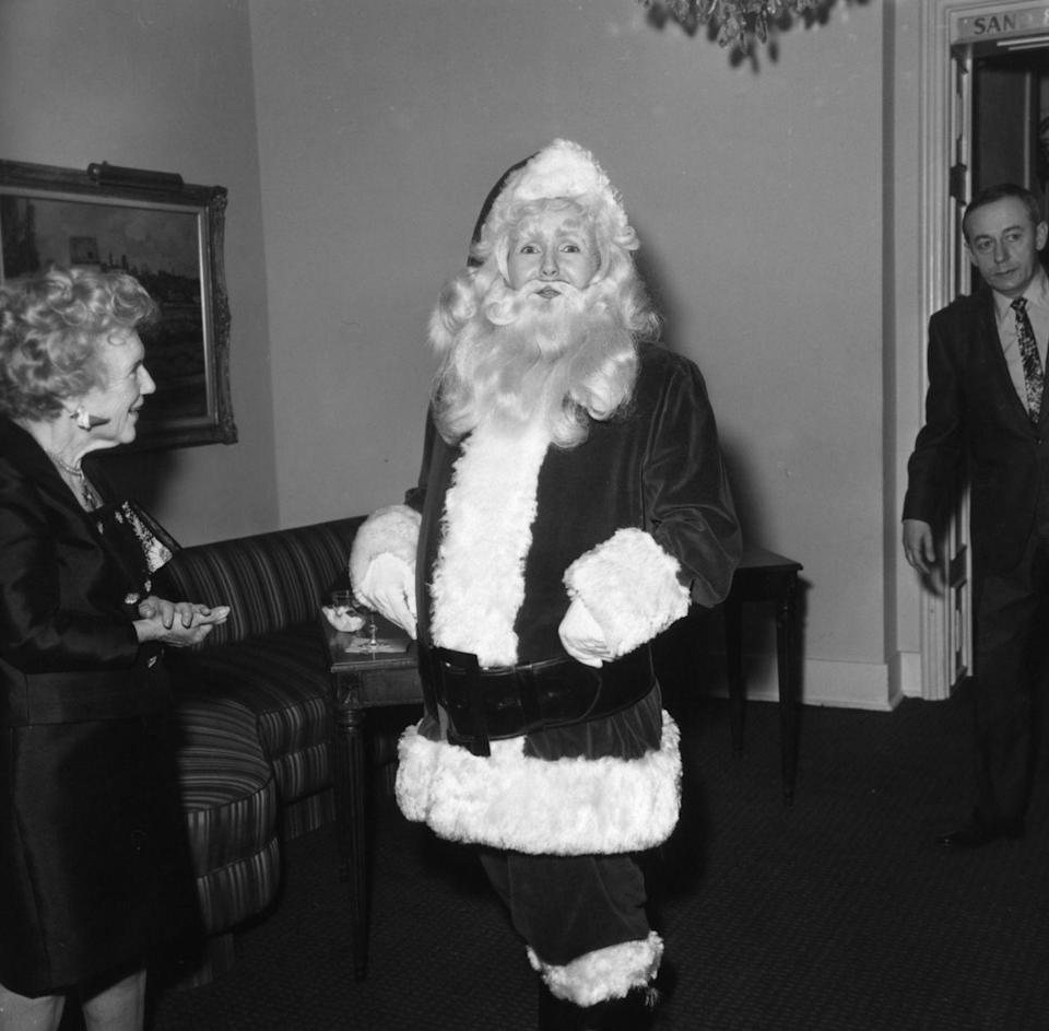 <p>The actress goes undercover as Old Saint Nick in Los Angeles, circa 1969.</p>