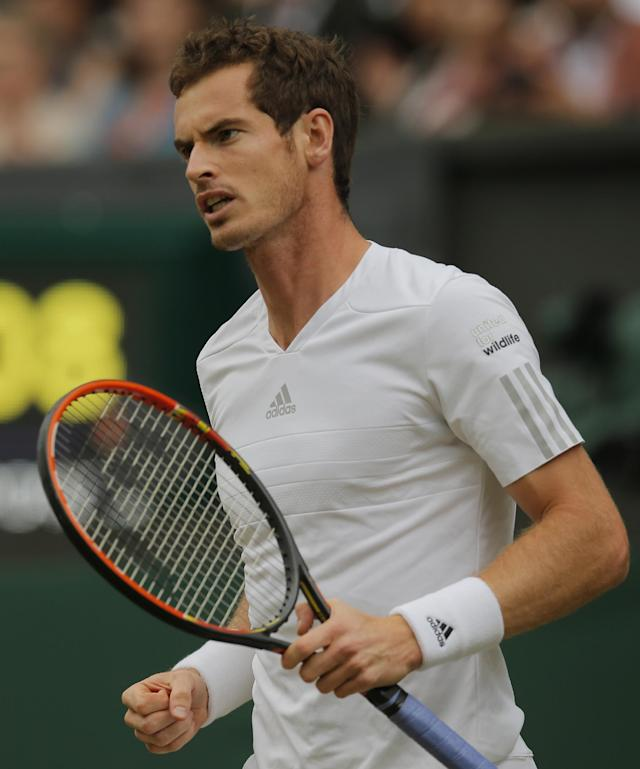 Andy Murray of Britain celebrates a point during the men's singles match against Kevin Anderson of South Africa at the All England Lawn Tennis Championships in Wimbledon, London, Monday, June 30, 2014. (AP Photo/Pavel Golovkin)