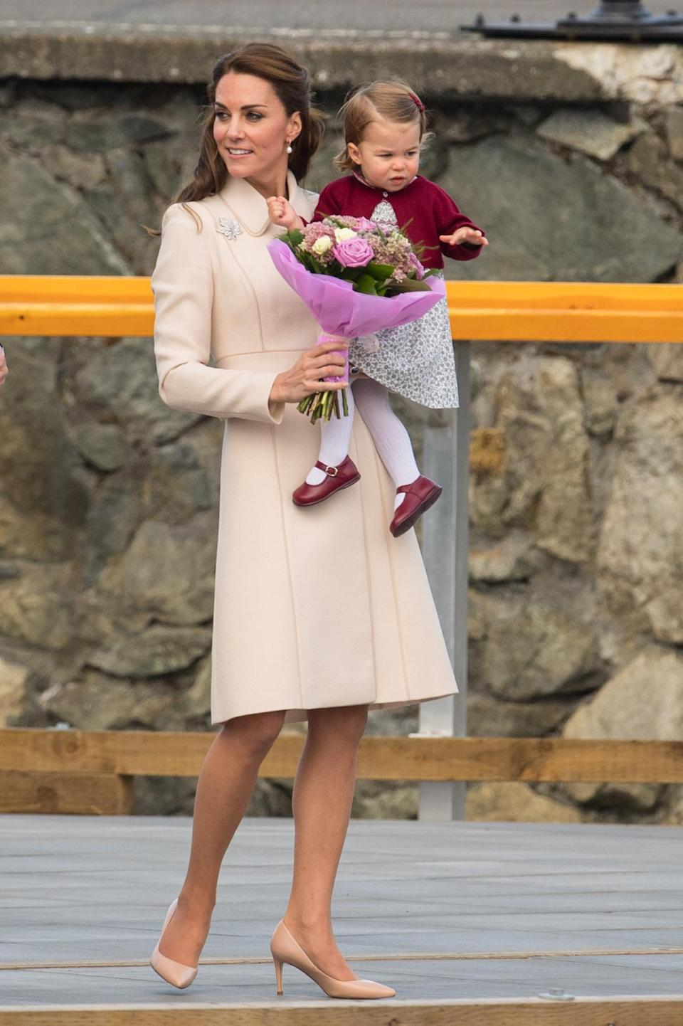 <p>As she bid farewell to Canada, the Duchess wore an elegant nude collared coat complete with matching satin heels. A maple leaf brooch - the emblem of Canada - proved a fitting accessory. </p><p><i>[Photo: PA]</i> </p>