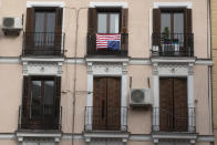 U.S. flag placed on a balcony of an apartment is hung upside-down, a sign of distress, in Madrid, Spain, Friday, Nov. 6, 2020. Votes in the U.S. presidential election between President Donald Trump and Democratic challenger Joe Biden are still being counted. (AP Photo/Paul White)
