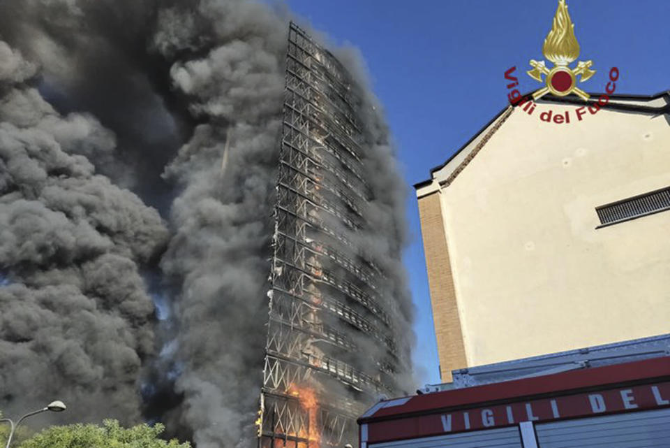 Smoke billows from a building on fire in Milan, Italy, Sunday, Aug. 29, 2021. (Vigili del Fuoco via AP)
