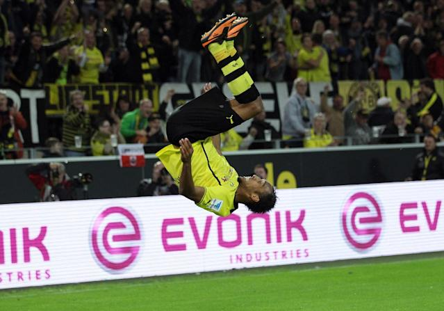 In this picture taken Sept. 14, 2013, Dortmund's Pierre-Emerick Aubameyang cheers after scoring during the Bundesliga soccer match between Borussia Dortmund and Hamburg SV in Dortmund, Germany. (AP Photo/dpa,Friso Gentsch)