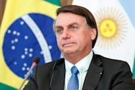 Brazilian president Jair Bolsonaro (pictured November 2020) got a popularity boost from the unemployment payment program, but keeping it up would put him at odds with his backers in the business world and his economy minister