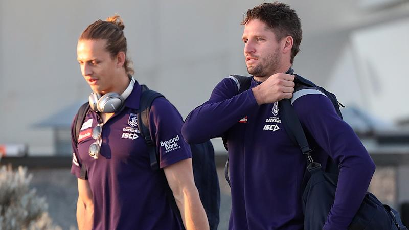 Jesse Hogan is pictured alongside Fremantle Dockers teammate Nat Fyfe.