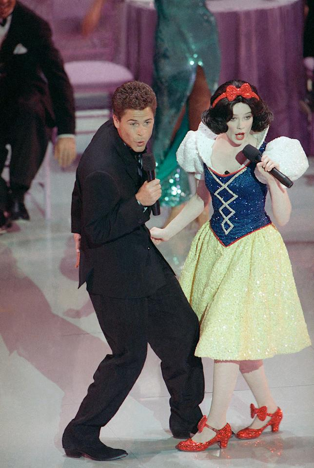 "Rob Lowe's duet with Snow White (1989): Allan Carr injected an element of high camp when he took over as producer of the Academy Awards. He was, after all, the man behind such splashy movie musicals as ""Grease"" and ""Can't Stop the Music,"" and he won a Tony for the Broadway hit ""La Cage aux Folles."" But his Oscar ceremony is considered one of the biggest flops in the show's history. It included a 20-minute opening dance number with a squeaky-voiced Snow White-lookalike singing ""Proud Mary"" with Lowe, who was just getting over a lewd videotape scandal. Just try and watch it without cringing."