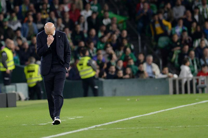 Real Madrid's French coach Zinedine Zidane reacts during the Spanish league football match between Real Betis and Real Madrid CF at the Benito Villamarin stadium in Seville on March 8, 2020. (Photo by CRISTINA QUICLER / AFP) (Photo by CRISTINA QUICLER/AFP via Getty Images)