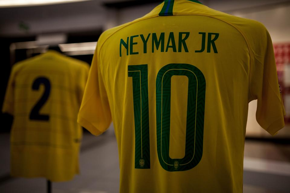 BOGOTA, COLOMBIA - JULY 05: The jersey of the Brazilian national team player, Neymar Jr, is shown during the San Siro jersey museum exhibition in Bogota, Colombia on July 05, 2019. An itinerant exhibition that has traveled for more than 25 countries, including China, Korea, Peru, Mexico and the United Arab Emirates. The museum, named after the Milan stadium, gathers several garments that travel the world in just two suitcases, the assembly has printed the photographs of the players and each shirt is located on a mannequin. Several World Cup shirts will be in Bogota in the company of football players like Pibe Valderrama, Ronaldo, Ronaldinho, Messi among others.  (Photo by Juancho Torres/Anadolu Agency/Getty Images)