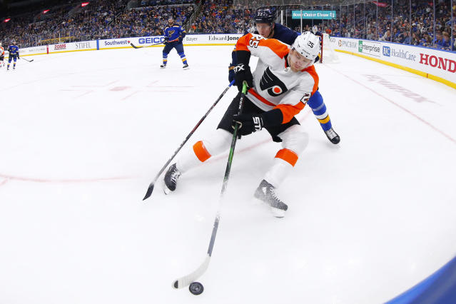 Philadelphia Flyers forward James van Riemsdyk (25) beats St. Louis Blues defenseman Niko Mikkola (77) of Finland to the puck during the first period of an NHL hockey game Wednesday, Jan. 15, 2020 in St. Louis. (AP Photo/Dilip Vishwanat)